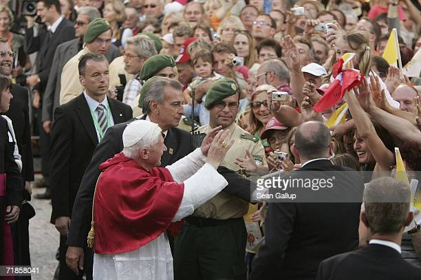 Pope Benedict XVI greets locals during a visit to the village of his birth on September 11 2006 in the village of Marktl am Inn Germany The Pope is...