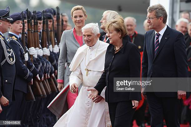 Pope Benedict XVI greets members of the German government cabinet upon his arrival at Tegel airport as German Chancellor Angela Merkel , German...