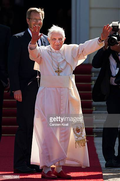 Pope Benedict XVI greets the guests as he visits German President Christian Wulff upon the Pope's speach at Schloss Bellevue palace on September 22...