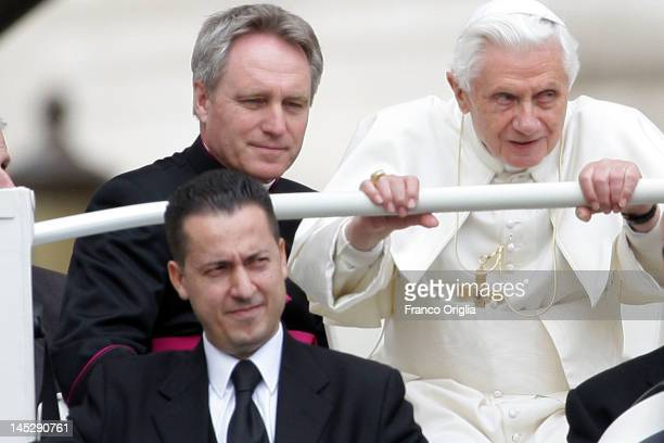 Pope Benedict XVI his personal butler Paolo Gabriele known also as 'Paoletto' his personal secretary Georg Ganswein arrive on popemobile in St...