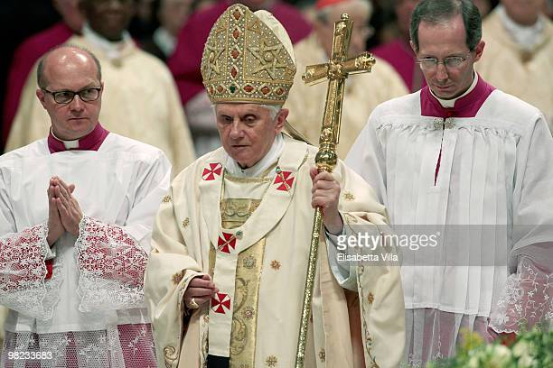 Pope Benedict XVI holds the cross during the Easter vigil mass in St Peter's Basilica on April 3 2010 in Vatican City Vatican The Easter Vigil Mass...