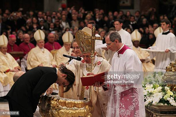 Pope Benedict XVI imparting the sacrament of Christening during the Easter Vigil on Holy Saturday night Vatican City 2012