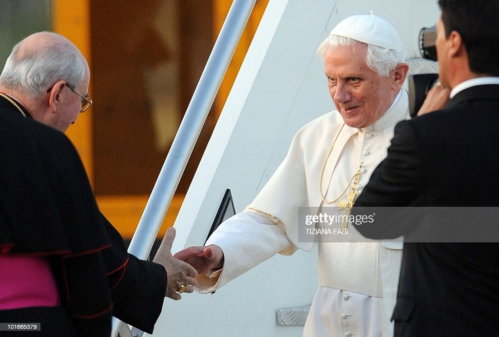 Pope Benedict XVI (C) is greeted by Cardinal Agostino Vallini (L) as he arrives at Rome's Ciampino military airport on June 6, 2010 after a three-day pilgrimage to Cyprus. Pope Benedict XVI wrapped up a visit to Cyprus with his eyes on the troubled Middle East, calling for an end to bloodshed and highlighting the plight of the region's Christians. AFP PHOTO/ Tiziana Fabi