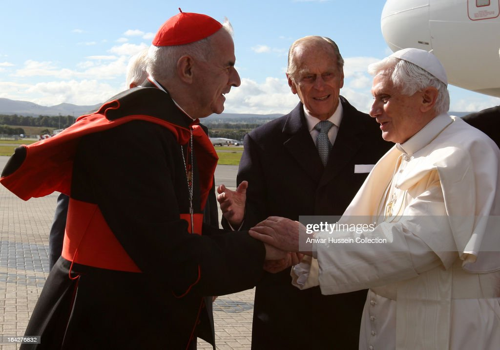 Pope Benedict XVI is greeted by Prince Philip, Duke of Edinburgh and Cardinal Keith O'Brien as he arrives at Edinburgh Airport at the start of his 4 day visit to Britain on September 16, 2010 in Edinburgh, Scotland.