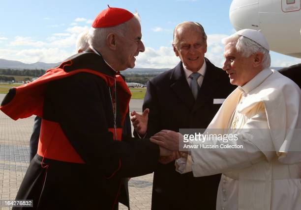 Pope Benedict XVI is greeted by Prince Philip Duke of Edinburgh and Cardinal Keith O'Brien as he arrives at Edinburgh Airport at the start of his 4...