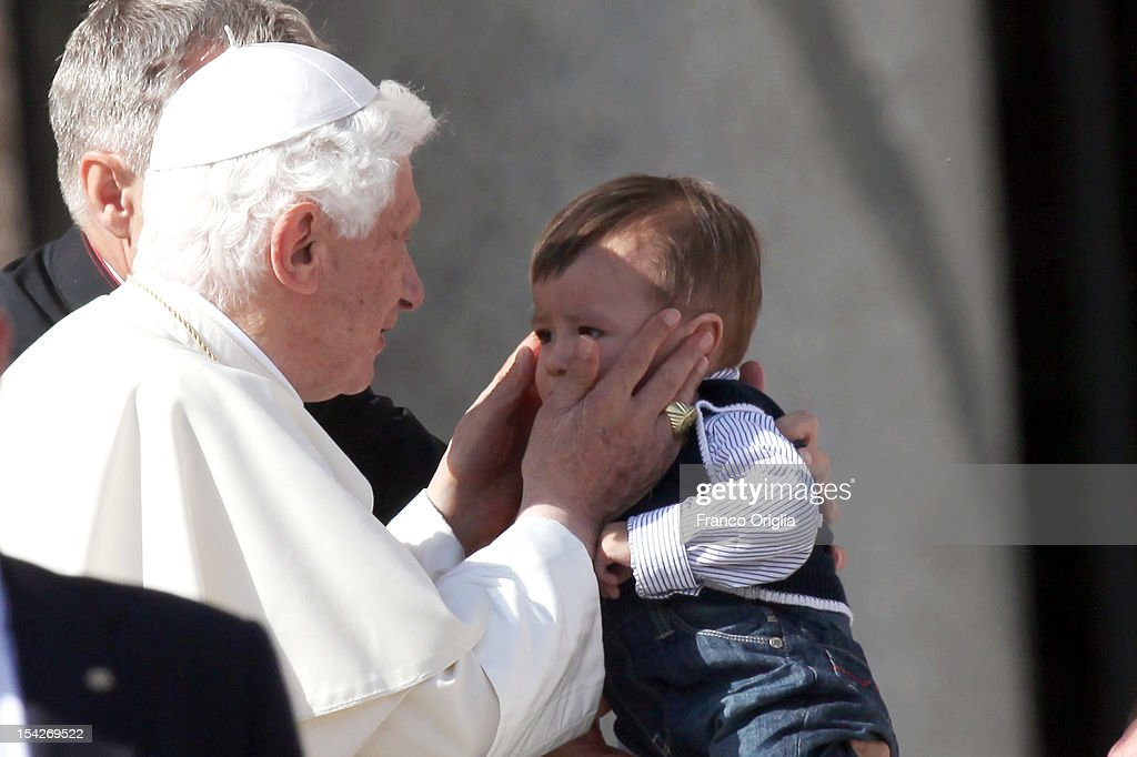 Pope Benedict XVI is handed a baby to bless as he leaves St. Peter's Square at the end of the weekly audience on October 17, 2012 in Vatican City, Vatican. Pontiff has called for a 'Delegation to visit Damascus in the next few days, on behalf of God and all of us, to express our fraternal solidarity to the Syrian population and deliver a special offering from the Synod Fathers and the Holy See'. Members of the delegation include: the Archbishop of Kinshasa, Cardinal Laurent Mosengwo Pasinya; President of the Pontifical Council for Interreligious Dialogue, Cardinal Jean-Louis Tauran and the Archbishop of New York, Cardinal Timothy Dolan.