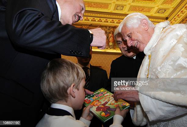 Pope Benedict XVI is handed a children's book by Nikolai, son of Belarus President Alexander Lukashenko - Pope Benedict XVI met Belarus President...
