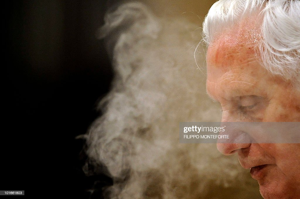 Pope Benedict XVI is shrouded in incense as he leads the Corpus Domini mass in Rome's Basilica of St John's in Lateran on June 3, 2010 / Filippo MONTEFORTE