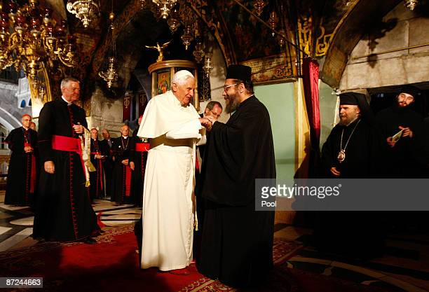 Pope Benedict XVI is welcomed by a Greek Orthodox Priest at the Golgotha or Calvary the traditional site where Jesus was crucified in the Church of...