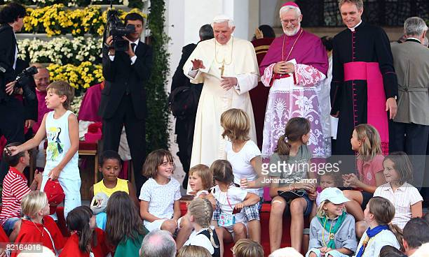 Pope Benedict XVI is welcomed by children in front of Brixen Cathedral after a sunday Angelus prayer on August 3 2008 in Brixen Italy Pope Benedict...