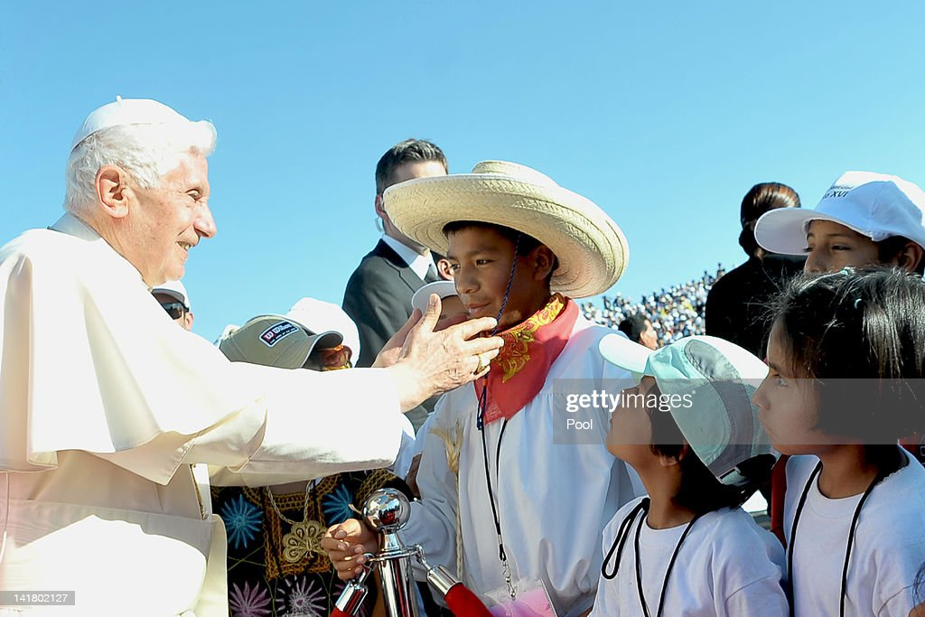 Pope Benedict XVI (C) is welcomed by children upon his arrival at Silao's international airport on March 24, 2012 in Guanajuato, Mexico. After visiting Mexico, Pope Benedict XVI will travel to Cuba, fourteen years after Pope John Paul II toured the communist country.