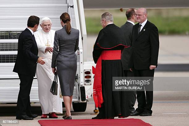 Pope Benedict XVI is welcomed by French President Nicolas Sarkozy and his wife Carla BruniSarkozy upon arrival at Orly airport south of Paris on...