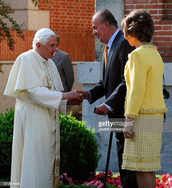 Pope Benedict XVI is welcomed by Spain's King Juan Carlos and Spain's Queen Sofia during a visit at the Zarzuela Palace in Madrid on August 19 2011...