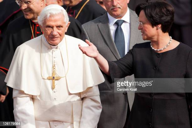Pope Benedict XVI is welcomed by the Federal Prime Minister of German state Thuringia Christine Leberknecht on the airport on September 23 2011 in...