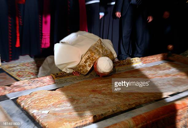 Pope Benedict XVI kisses the Stone of Anointing where Christians believe the body of Jesus was washed before his burial at the Church of the Holy...