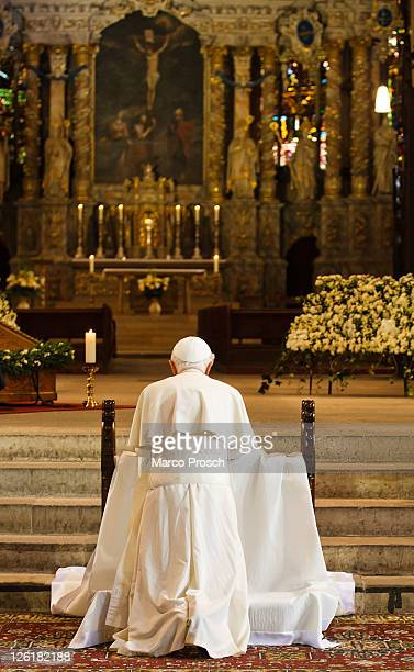 Pope Benedict XVI kneels to pray at the main altar of the Dom cathedral on September 23 2011 in Erfurt Germany The Pope is in Erfurt on the second of...