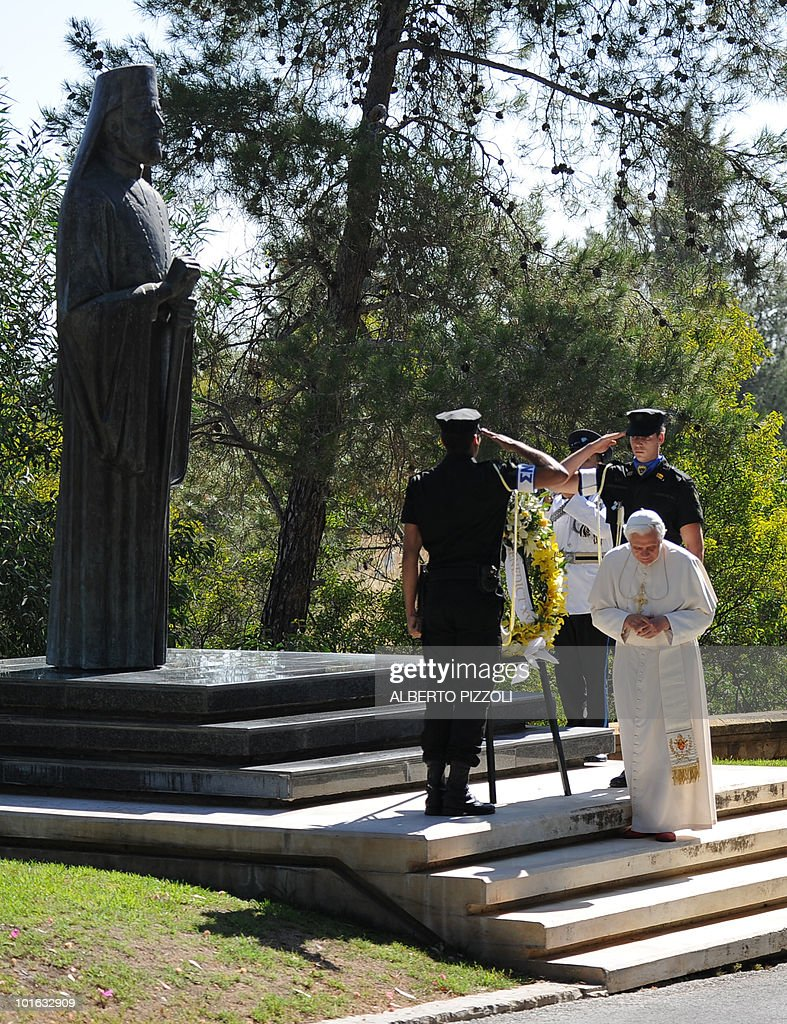 Pope Benedict XVI lays a wreath at the statue of the late President of the Republic of Cyprus Archbishop Makarios III as Cypriot President Demetris Christofias (R) stands next to him at the presidential palace in Nicosia on June 5, 2010 on the second day of the pontiff's visit to the mainly Greek Orthodox Mediterranean island.