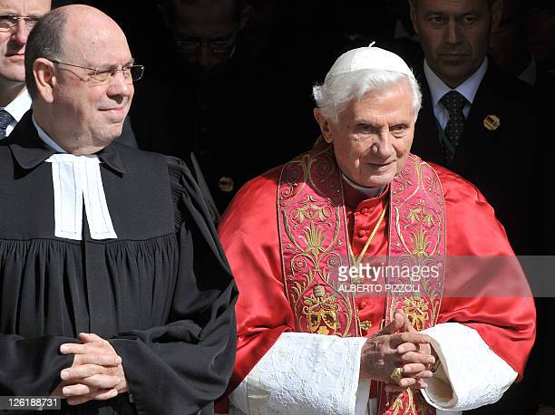 Pope Benedict XVI leaves the Erfurt protestant monastery of St. Augustin with Praeses Nikolaus Schneider , president of the council of the German...