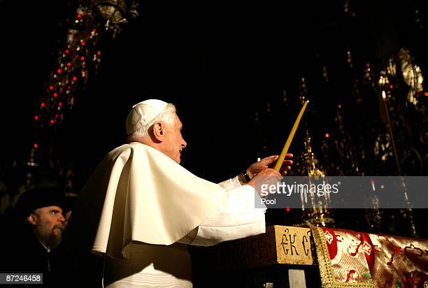 Pope Benedict XVI lights a candle in the Golgotha or Calvary the traditional site where Jesus was crucified in the Church of the Holy Sepulchre on...