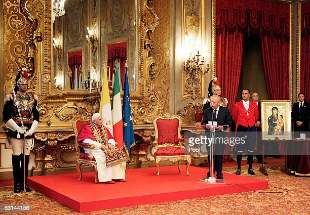 Pope Benedict XVI listens to Italy's President Carlo Azeglio Ciampi speak during an official visit at the Quirinale Presidential palace June 24 2005...