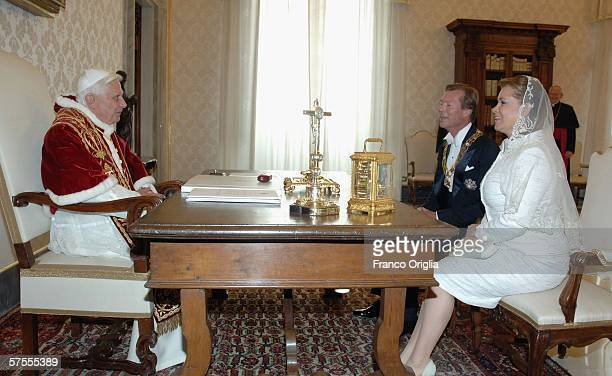 Pope Benedict XVI meets Grand Duke Henri of Luxemburg and Grand Duchess MariaTeresa of Luxemburg at his private library May 8 in Vatican City