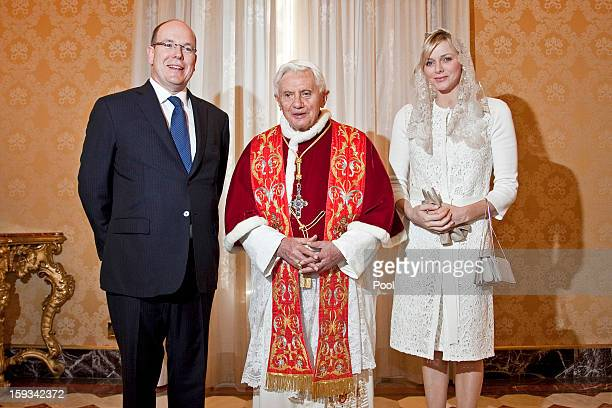 Pope Benedict XVI meets HSH Prince Albert II of Monaco and HSH Princess Charlene of Monaco during a private audience at his library on January 12...