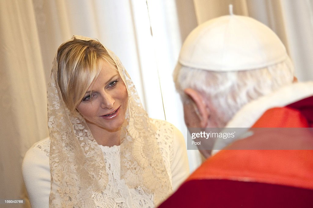 Pope Benedict XVI meets HSH Princess Charlene of Monaco during a private audience at his library on January 12, 2013 in Vatican City, Vatican.