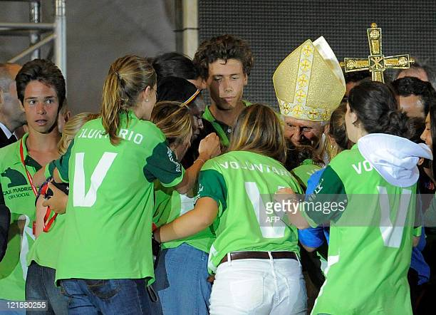 Pope Benedict XVI meets volunteers after leadding a Prayer Vigil at the Cuatro Vientos air base in Madrid on August 20 2011 during the World Youth...