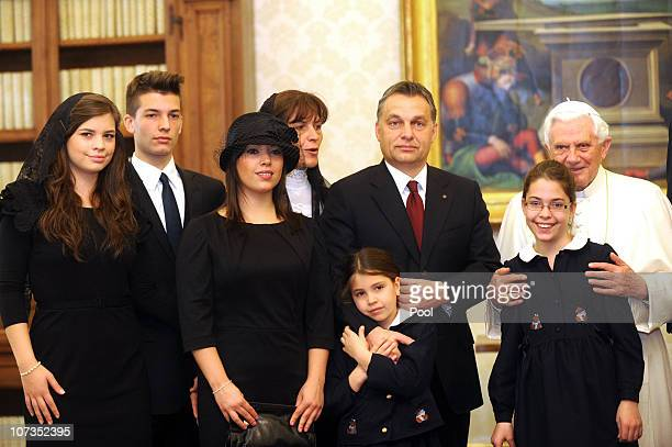 Pope Benedict XVI meets with Hungary's Prime Minister Viktor Orban his wife Aniko Levai and their five children at his private library on December 6...