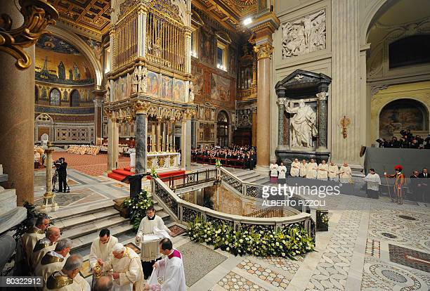 Pope Benedict XVI performs a ritual washing of the feet during a mass at St John in Lateran Basilica commemorating Christ's Last Supper with his...