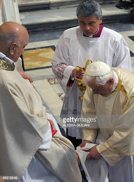 Pope Benedict XVI performs the ritual of washing of the feet during the Evening mass of the Lord� Supper celebrated on Maundy Thursday in Lateran...