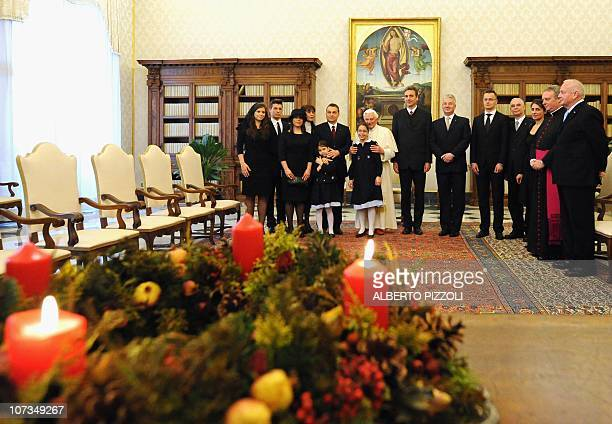 Pope Benedict XVI poses with Hungary's Prime Minister Viktor Orban his wife Aniko Levai their five children and members of the Hungarian delegation...
