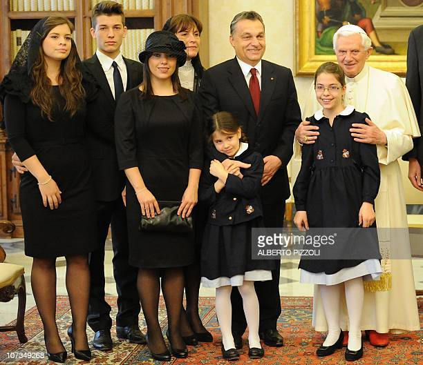 Pope Benedict XVI poses with Hungary's Prime Minister Viktor Orban his wife Aniko Levai and their five children during a private audience at The...
