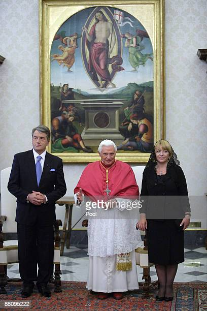 Pope Benedict XVI poses with Ukrainian President Victor Yushchenko and his wife Kateryna Mykhailiva Yushchenko during their meeting at his private...