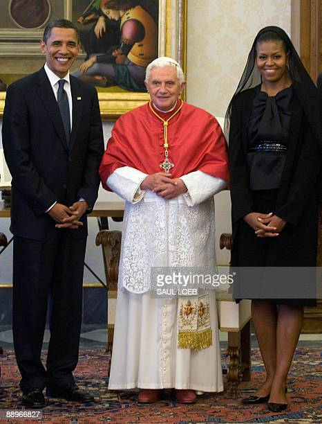 Pope Benedict XVI poses with US President Barack Obama and US First Lady Michelle Obama during an audience on July 10, 2009 at The Vatican. Obama was...