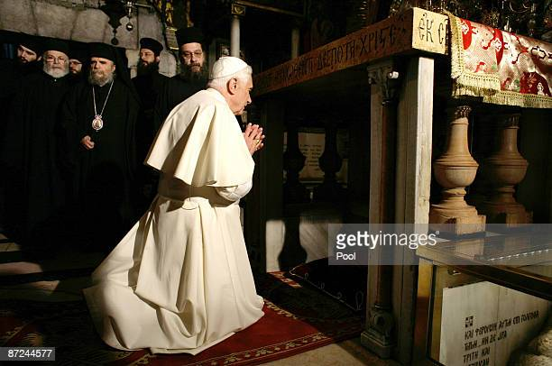 Pope Benedict XVI prays at the Golgotha or Calvary the traditional site where Jesus was crucified in the Church of the Holy Sepulchre on May 15 2009...