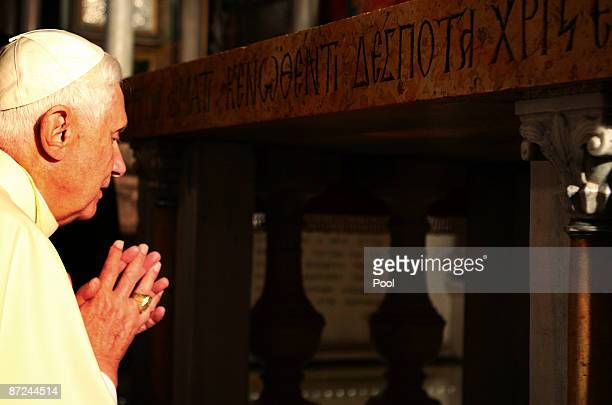 Pope Benedict XVI prays at the traditional site where Jesus was crucified in the Golgotha or Calvary in the Church of the Holy Sepulchre on May 15...
