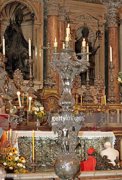 Pope Benedict XVI prays in font of the glass vial with San Gennaro's blood in the San Gennaro of the Cathedral of Naples 21 October 2007 Pope...