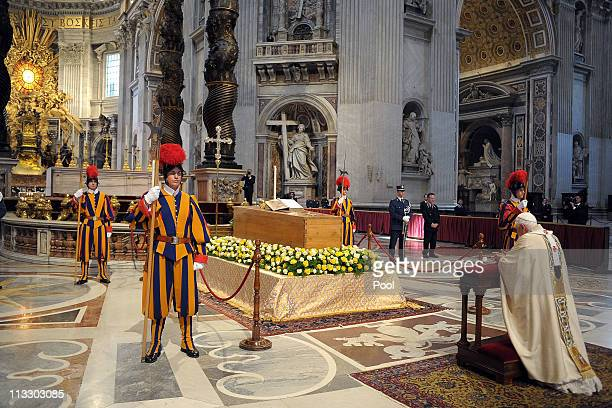 Pope Benedict XVI prays in front of the coffin of John Paul II at St Peter's Basilica at the end of John Paul II Beatification Ceremony on May 1 2011...
