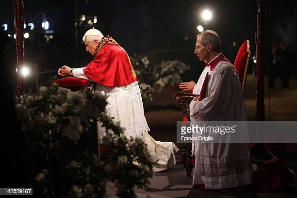Pope Benedict XVI presides over the Way Of The Cross procession at the Colosseum on Good Friday April 6 2012 in Rome Italy The traditional Catholic...