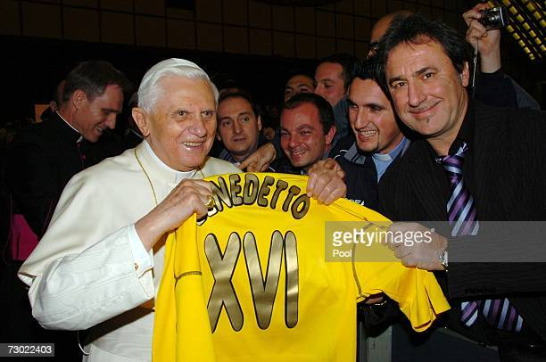 Pope Benedict XVI receives a football jersey with his name in gold letters during his weekly audience at the Paul VI Hall on January 17 2006 in...