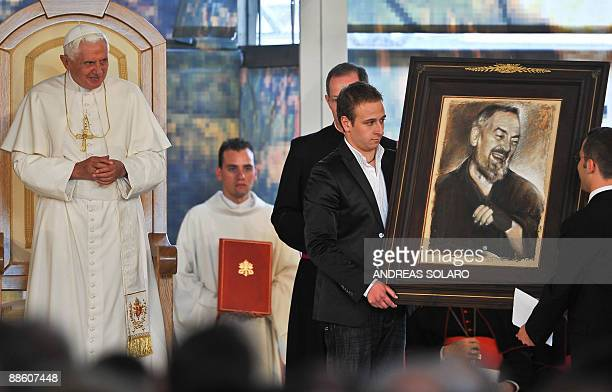 Pope Benedict XVI receives a gift during his meeting with priests religious and youth at Renzo Piano church dedicated to Padre Pio in San Giovanni...