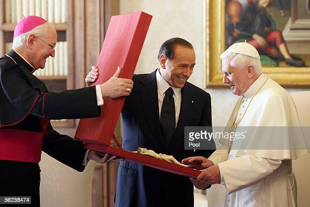 Pope Benedict XVI recieves a gift from Italian Prime Minister Sivio Berlusconi during their meeting November 19 2005 in Vatican City This is the...
