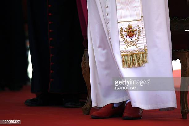 Pope Benedict XVI red shoes are pictured as he attends a gathering with the small Cypriot Catholic community at a Maronite elementary school in...