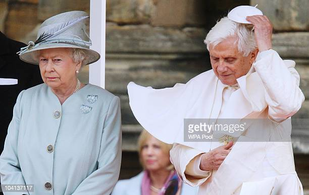 Pope Benedict XVI replaces his zucchetto as he meets with Queen Elizabeth II during day one of his four day state visit to the United Kingdom at...