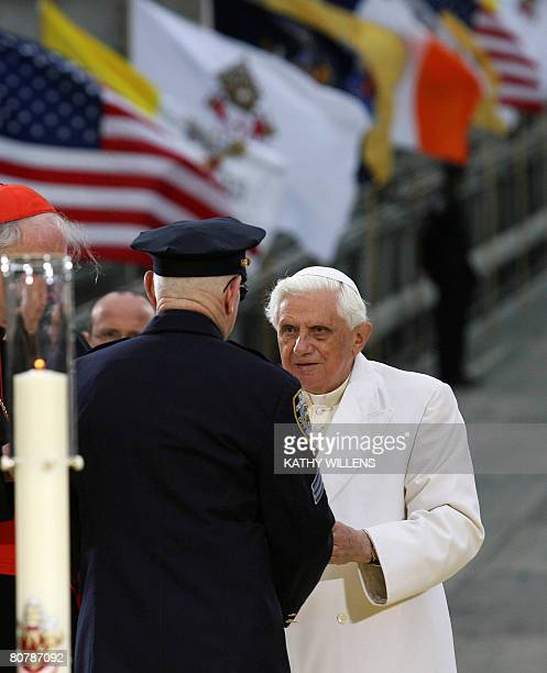 Pope Benedict XVI right meets with a first responder after praying and lighting a candle at ground zero in New York Sunday April 20 2008 Benedict XVI...