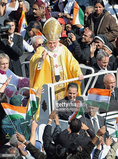 Pope Benedict XVI salutes pilgrims from India in St Peter's square at the Vatican on October 12 2008 during the Canonization ceremony of Sister...
