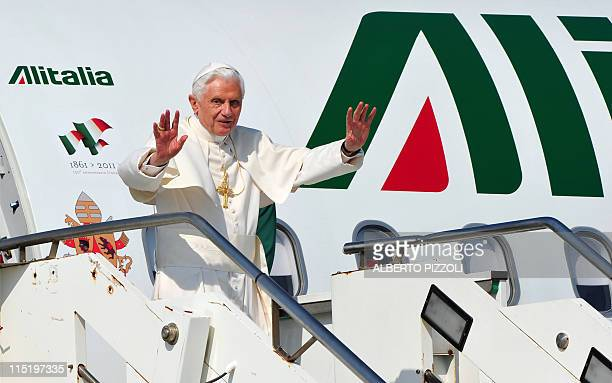 Pope Benedict XVI salutes while boarding a plane before leaving for Croatia on June 4, 2011 at Rome's Fiumicino international airport. Croatia's...
