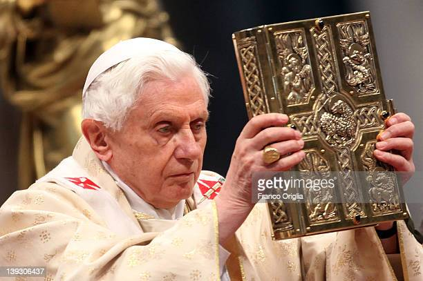 Pope Benedict XVI shows the gospel as he celebrates a mass with newly appointed cardinals at St Peter's Basilica on February 19 2012 in Vatican City...