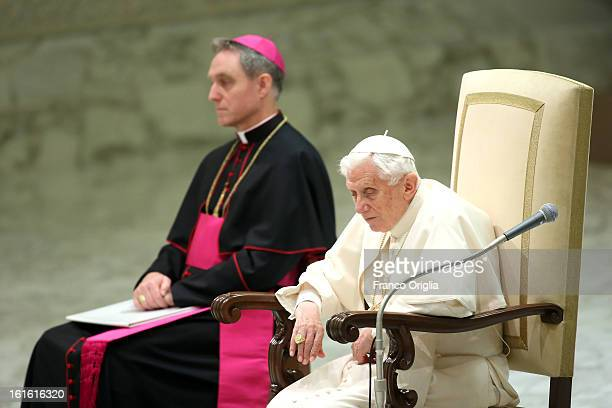 Pope Benedict XVI sits beside his personal secretary Georg Ganswein during his weekly audience on February 13 2013 in Vatican City Vatican The...